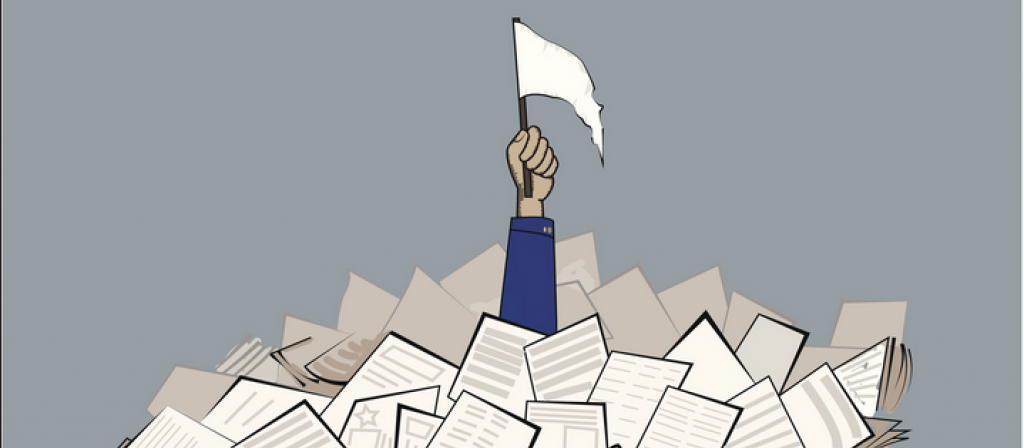 image of surrendering under a pile of paperwork
